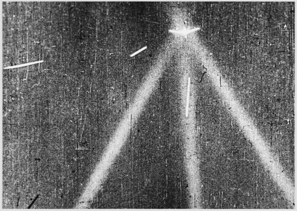 A German bomber is caught in the beams of three Russian searchlights, making it a fine target for the anti-aicraft guns