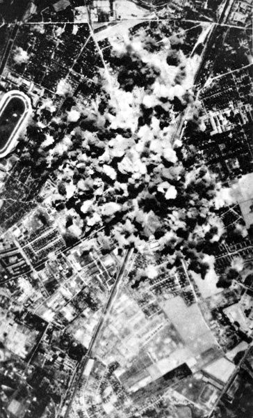Photograph showing bombs exploding in Berlin's industrial zone during an Allied air-raid on the German capital, 6th August 1944