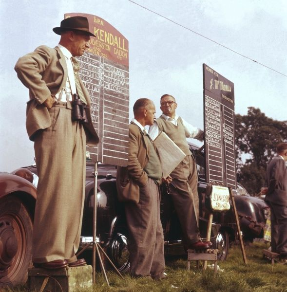 Kendall and McManus bookmakers stand by their blackboards as the race commences. Top tips include No.2, Westcroft