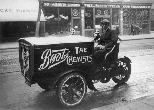 A glum looking deliveryman sits aboard his Boots The Chemists delivery van