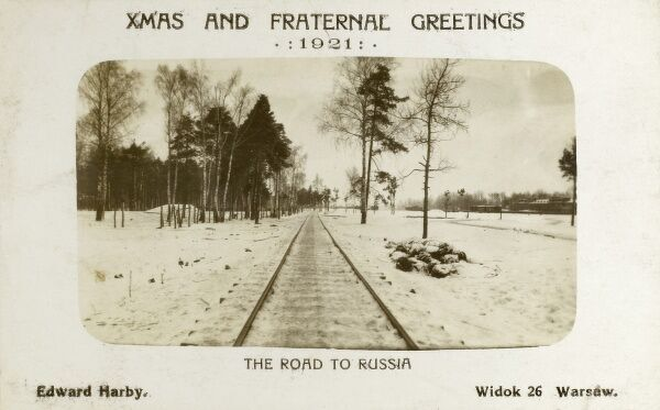 British macabre sense of humour on a Christmas card.... 'The Road to Russia' The bleak landscape at the border between Poland and Russia. Is there a body in the mysterious pile of snow and wire-covered bundles on the right......?! Date: 1921