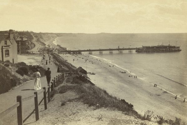 The beach at Bournemouth, Dorset, showing the pier. Date: circa 1890s