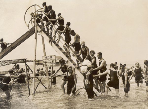 Bathers at Bournemouth wait their turn for a go on the water chute