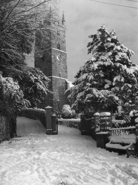Winter snow on the church at Bovey Tracey, Devon, England. Date: 1950s