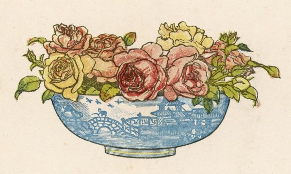 A pretty blue willow pattern bowl full of pink & yellow roses