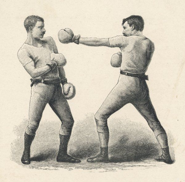 A boxer steps away from his opponent's left jab, avoiding the punch successfully