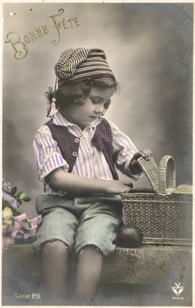 A little boy looks inside his picnic basket