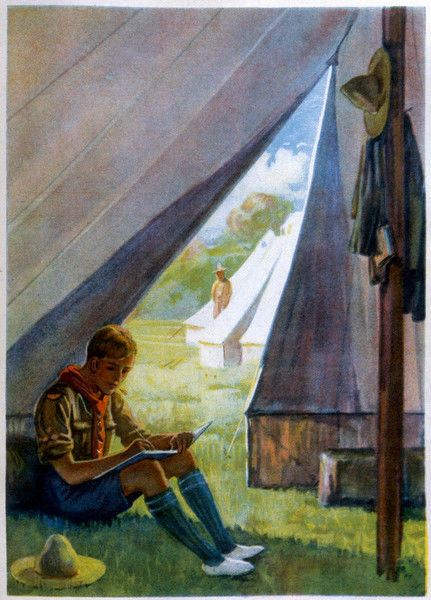 A boy scout sits in his tent, making notes in a book Date: 1923