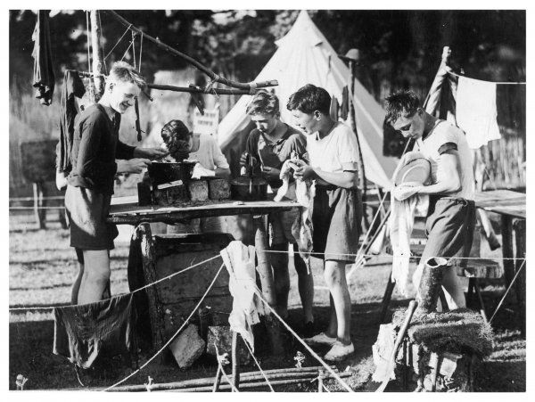 Washing up does not seem such an irksome task after all, to this group of boy scouts. They are part of a scout camp at Selhouse Broad, Wroxham, also attended by Lord Baden Powell