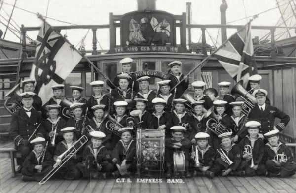 Members of the Boys Band posing on the deck of the Training Ship Empress, operated at Helensburgh (Dunbartonshire, Scotland) on the Clyde, by the Clyde Industrial Training Ship Association. The Empress replaced an earlier vessel, the Cumberland