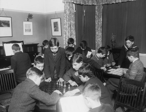 Evenings at a Boys Club needn't be a dull affair with plenty of activities to get involved in, including chess, playing the piano, playing cards, and reading. Not a Playstaton or iPod in sight!