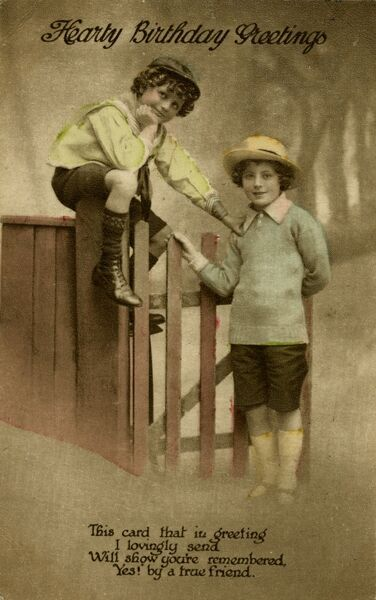 Two boys at a garden gate on a birthday postcard.  1919
