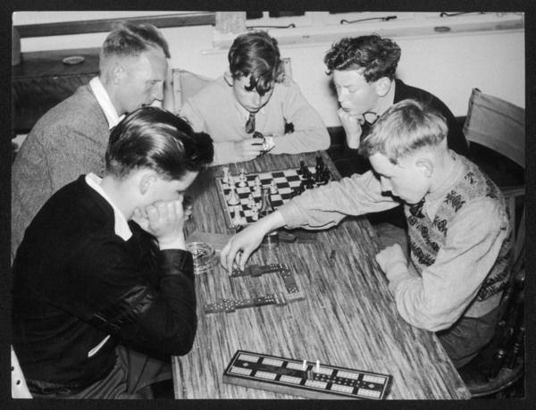 Evening relaxtion at the King's Youth Hostel, Dolgelly, Wales, as dominoes and chess are played