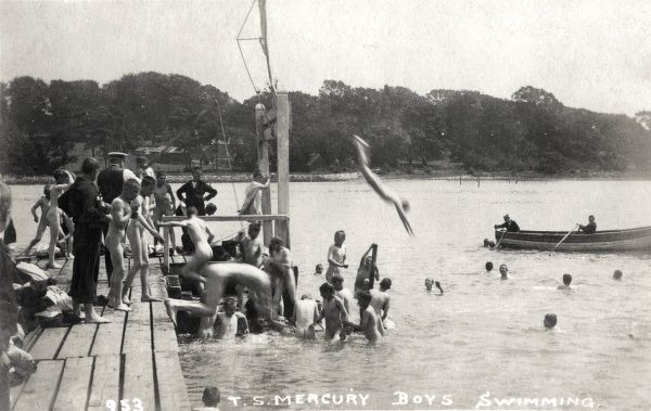 Boys from the Training Ship Mercury swimming nude in the River Hamble. The Mercury, established in 1885 by the London philanthropist Charles Hoare, was originally based at Binstead on the Isle of Wight, but moved in 1892 to the River Hamble