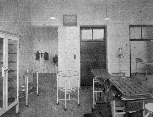 The operating theatre in the new poor law infirmary opened in 1905 at the Bradford Union workhouse in West Yorkshire. The fittings include an operating table, trolleys and a cabinet containing surgical instruments. Date: 1905