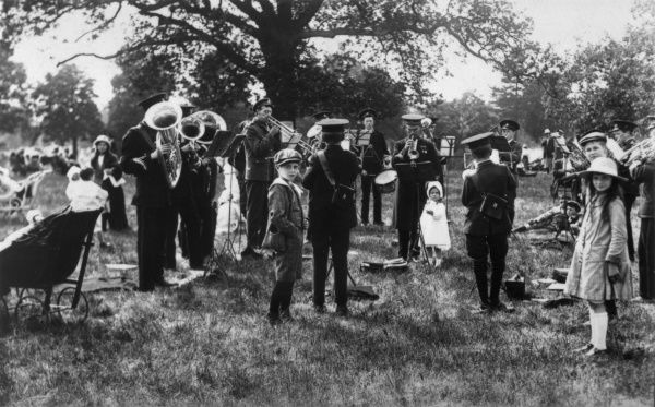 A brass band (military or Salvation Army) playing at a children's day, Knebworth House
