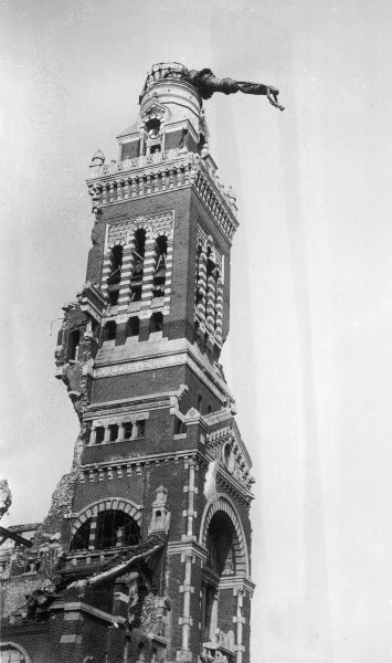 The Tower of the Church of Notre Dame de Brebieres, in Albert. At the top of the tower the golden figure of the Virgin Mary holding aloft the infant Jesus hangs precariously, having been hit by a German shell in 1915, but secured in place by French engineers