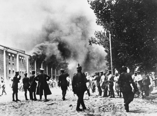 Buildings on fire in the city of Brest-Litovsk. The city was captured by German forces in December 1915, and in March 1918 was the scene of the signing of a treaty which ended the war between Russia and Germany. The city now lies in Belarus