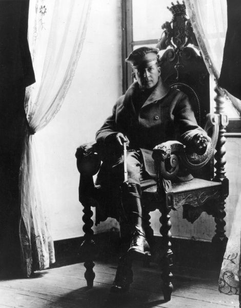 Brigadier General Douglas Macarthur (1880-1964), American army officer of the 84th Brigade, 42nd Division, sitting in an ornate chair at St Benoit Chateau, northern France, towards the end of the First World War