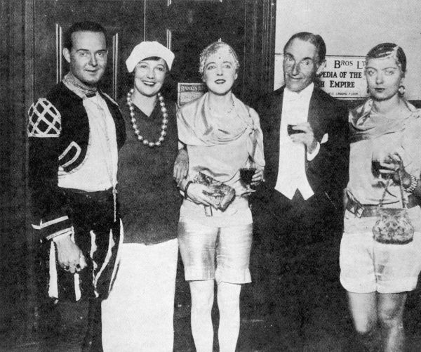 Group photograph of William Acton, Mrs Arthur Bendir, Elizabeth Ponsonby, Harry Melville and Babe Plunket-Greene taken at the fancy dress ball hosted by David and Hermione Tennant at the Adelphi Terrace