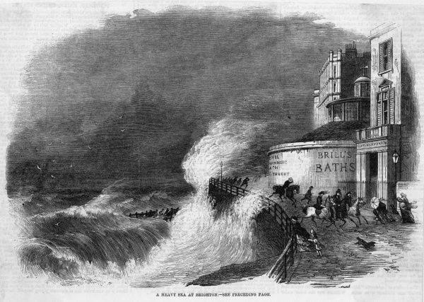 Rough seas add excitement to the outings of riders and walkers on the sea front at Brighton, Sussex
