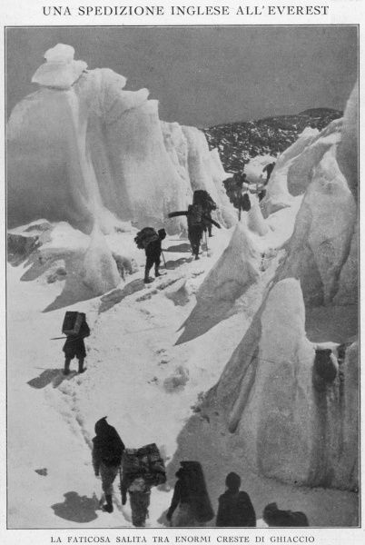 Members of the British Everest Expedition walk through an icy corridor