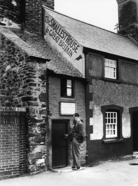 'Tom Thumb's House', Conway, north Wales, reputed to be the smallest house in Britain. A 6 foot 3 inch tenant lived here for 15 years! Date: late 1930s