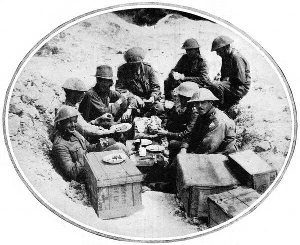 Official photograph from August 1916 showing a group of Australian soldiers stopping for lunch during the British advance at the Western Front, probably the Battle of the Somme which occurred in July 1916