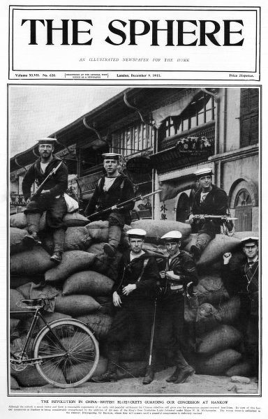 British blue jackets poses against a wall of sandbags in front of the British concession at Hancow, China during the Chinese rebellion of 1911. Date: 1911
