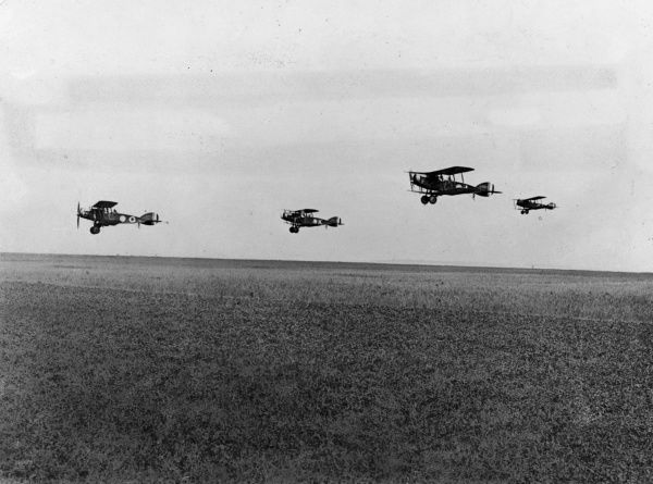 British Bristol fighter planes of No. 22 Squadron RAF flying in formation from Serny aerodrome, northern France, during the First World War. Date: June 1918