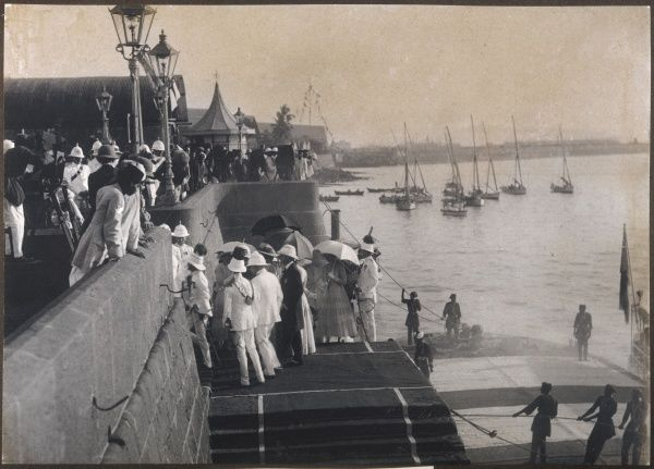 British colonials arrive at Bombay docks, India, and are welcomed ashore