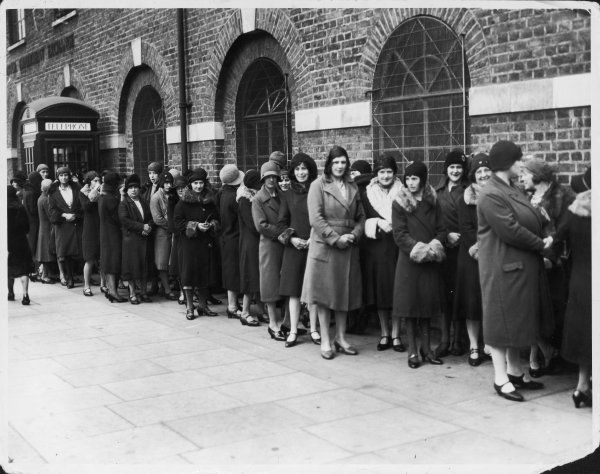 Unemployed working class women queueing for the Dole during the Depression