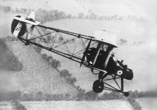 A British FE2B bomber biplane in flight over fields during the First World War. Date: 1914-1918