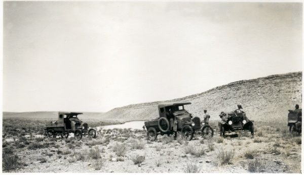 A convoy of British ground support vehicles with an Indian driver in hilly desert, somewhere in the Middle East