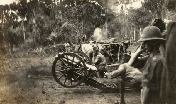 A British gun battery in action in Cameroon, west central Africa, during the First World War. The officer on the right is Lieutenant Colonel Haywood DSO. Date: circa 1914-1916
