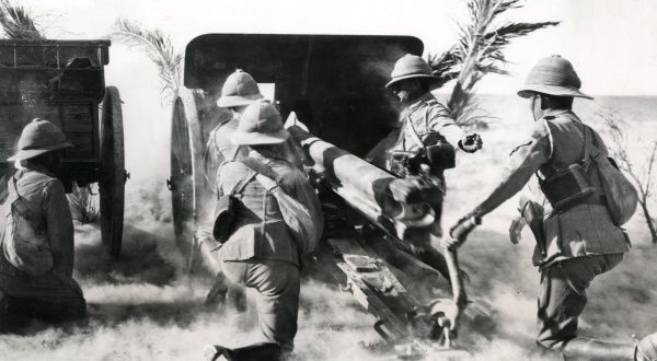 British gunners firing a captured gun against the enemy in the Palestine desert during the First World War. Date: circa 1917-1918