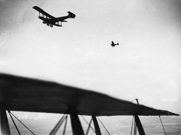 A British Handley Page heavy bomber biplane (left) belonging to No. 48 Squadron RAF, and a Bristol fighter plane (right), flying over Cologne, Germany. Date: May 1919