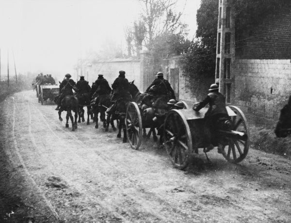 British Horse Artillery galloping through Mailly-Maillet on the Western Front in France during World War I in March 1918
