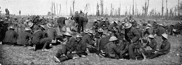 Photograph showing members of a British labour Battalion having their lunch near the Western Front, France, 1916