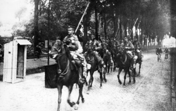 British Lancers riding along a road in France during the First World War. Date: 1914-1918