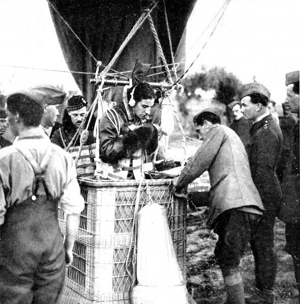 A British observation-officer testing the communications equipment which allowed him to speak to the ground when aloft in his kite-balloon. Such balloons were tethered to the ground and used by artillery batteries to observe the surrounding terrain