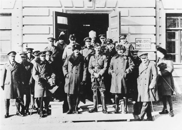 Staff Officers of the British Military Mission to Siberia, at their headquarters in Vladivostock. The head of the military Mission, Major General Alfred Knox, is to the centre left of the picture (in Russian fur hat) with his Chief of Staff on his left