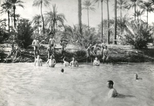 British soldiers enjoying some nude bathing in a river at Busra, Mesopotamia (now Basra, Iraq) during the First World War. Date: circa 1916