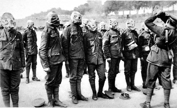 British soldiers are shown at drill, being instructed on the use of their respirators in case of a gas attack
