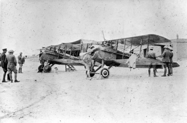 British Spad VII fighter biplanes with members of 30 Squadron RFC (Royal Flying Corps) on an airfield in the Middle East during the First World War. Date: 1916-1918