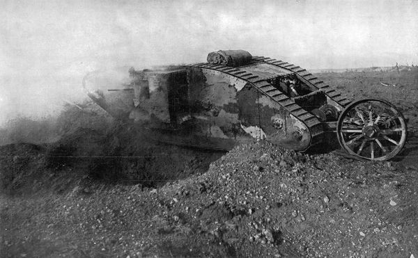 Photograph showing a British tank going into action on the Western Front in France, during the autumn of 1916. This machine appears to be a Mark V 'Male' tank