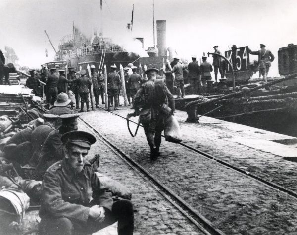 British troops landing wooden stakes and fascines (bundles of wood used in military defences) at Salonika (Salonica, Thessaloniki, Greece) during the First World War. Date: 14 November 1915