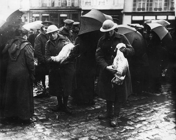 British troops buying geese in a street market at Bailleul, northern France, during the First World War, no doubt for their Christmas dinner. Date: December 1916
