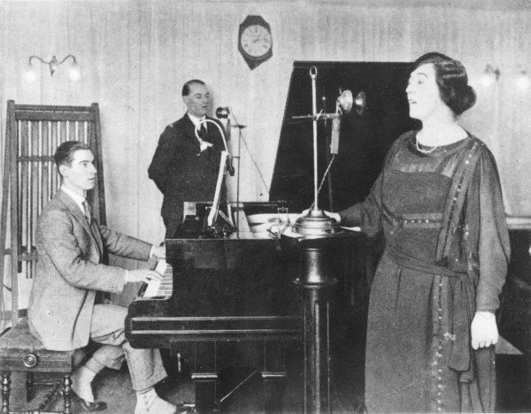 A scene from the earliest days of broadcasting : Olive Sturgess and John Huntingdon perform a duet at BBC Marconi House