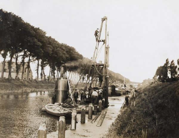 British troops constructing a new wharf on a canal on the Western Front during the First World War. Date: 1914-1918